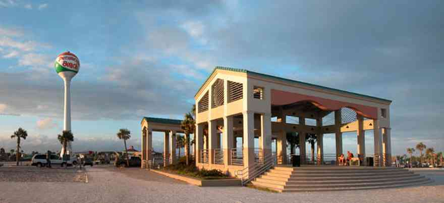 Pensacola-Beach:-Casino-Beach-Pavillion_01.jpg:  open-air pavillion, gathering place, temple, shelter, columns, steps, beach ball, water tower, palm trees, beachfront, sand