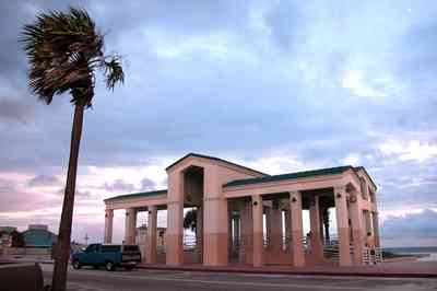 Pensacola-Beach:-Casino-Beach-Pavillion_04.jpg:  temple, pavillion, amphitheater, palm tree, beachfront, parking lot,