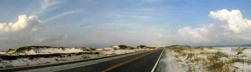 Pensacola-Beach:-Dunes-Road_01.jpg:  santa rosa island, gulf of mexico, gulf islands national seashore, escambia county, cumulus clouds, beach, sand dunes, emerald coast, two-lane road, curving road