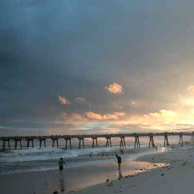 Pensacola-Beach:-Gulf-Fishing-Pier_02.jpg:  sunset, clouds, surf, surfers, sand, gulf of mexico