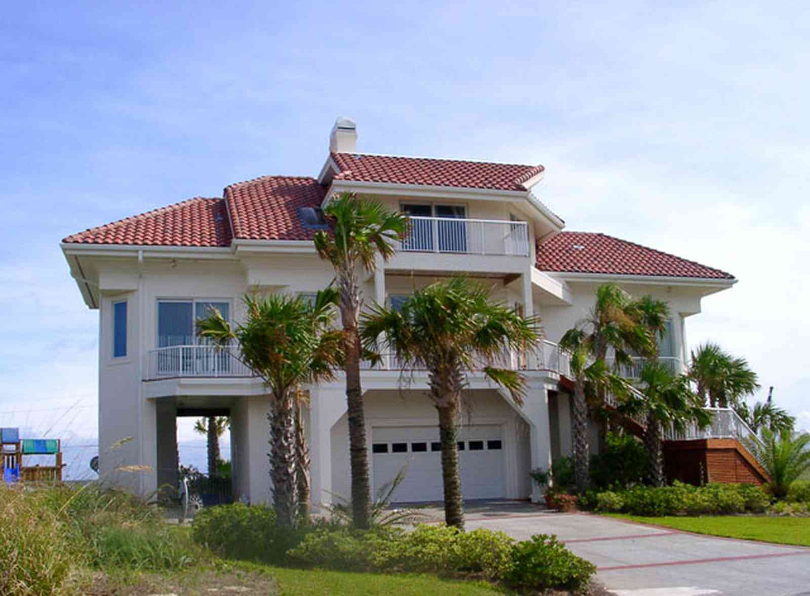 Pensacola-Beach:-Hermosa-St-Homes_13.jpg:  mediterrean villa, palm tree, gulf of mexcio, red tiled roof