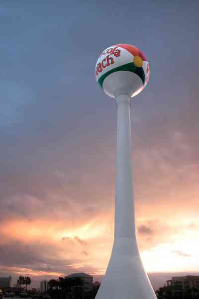 Pensacola-Beach:-Sunset_00.jpg:  water tower, sunset, palm tree, beach ball, mixed skies
