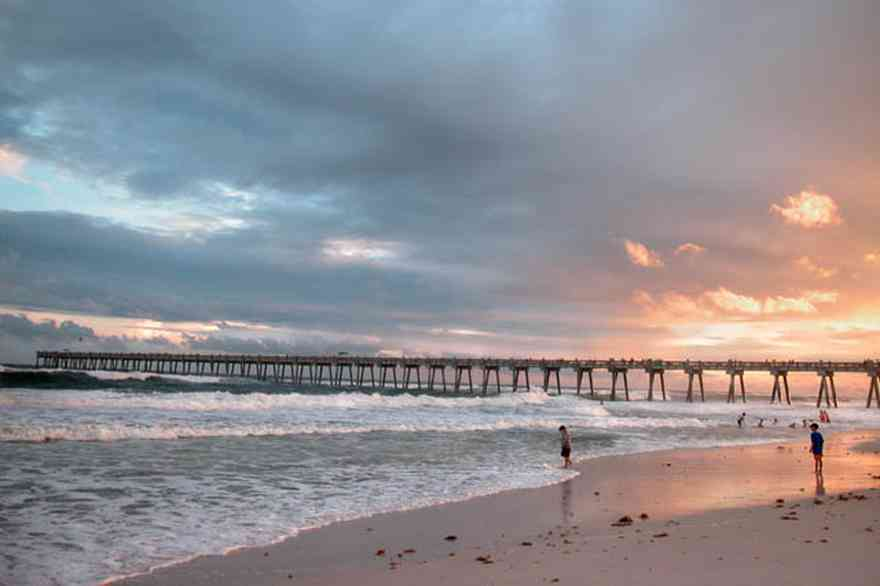 Pensacola-Beach:-Sunset_04.jpg:  fishing pier, sunset, surf, surfers, waves, gulf of mexico, swimmers, bathers, tropical storm, mixed skies