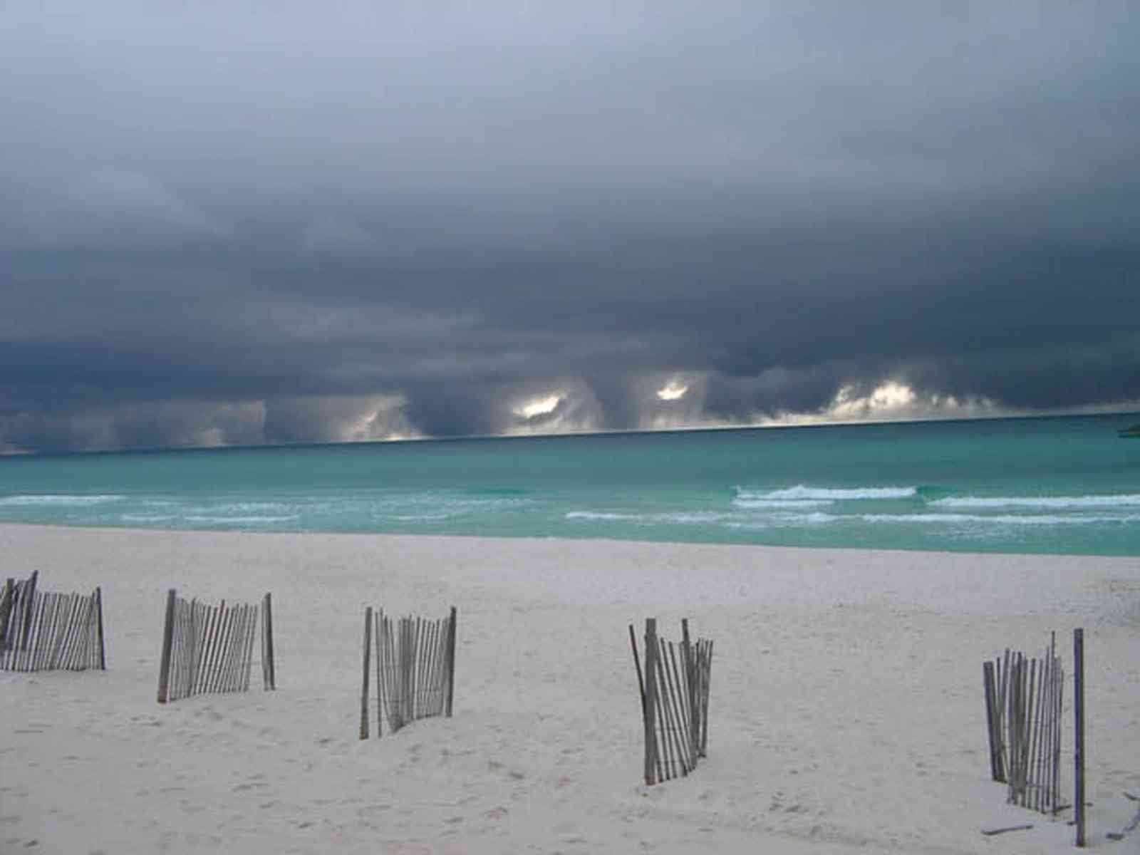 Pensacola-Beach:-Waterfront_13a.jpg:  weather front, storm, seashore,  beach, emerald water, dune fences, gulf of mexico, surf