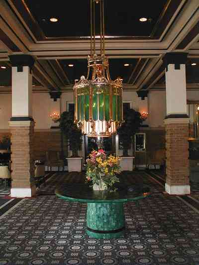 Pensacola:-Crowne-Plaza-Pensacola-Grand-Hotel_02.jpg:  hotel, railroad station, downtown, stained glass, marble table, tiffany lamp
