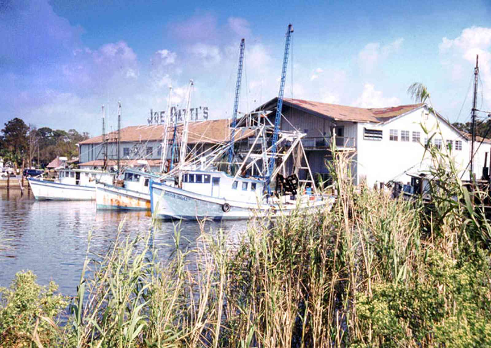 Pensacola:-Downtown:-Joe-Patti-Seafood_02.jpg:  joe patti's seafood, fishing boat, store, marsh grass,