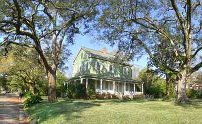 Pensacola:-East-Hill:-10th-Avenue-House_03.jpg:  oak trees, two-story home, porches, gallery ,