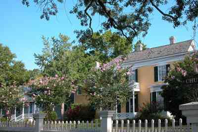 Pensacola:-Historic-Pensacola-Village:-Dorr-House_11.jpg:  picket fence, cottage, folk victorian house, wood shingle roof, oak tree