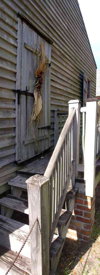 Pensacola:-Historic-Pensacola-Village:-Julee-Cottage_03.jpg:  porch, slave cottage, victorian house, brick pillars, rough wood