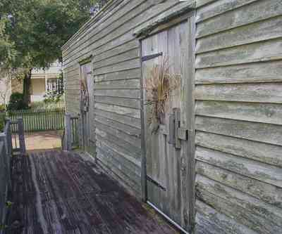 Pensacola:-Historic-Pensacola-Village:-Julee-Cottage_05.jpg:  slave quarters, julee cottage, back porch, rough-hewn wood, deck, picket fence, pensacola historic village