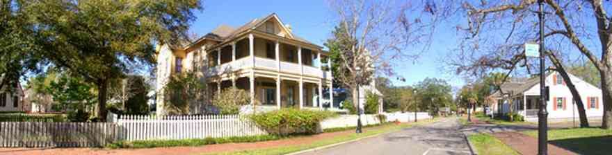 Pensacola:-Historic-Pensacola-Village:-Lear-Rocheblave-House_01.jpg:  victorian house, gingerbread trim, white picket fence, brick sidewalk, historic village