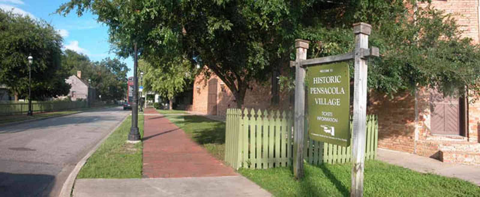 Pensacola:-Historic-Pensacola-Village:-Museum-Of-Commerce_00.jpg:  picket fence, streetscape, victorian village, warehouse building, museum complex