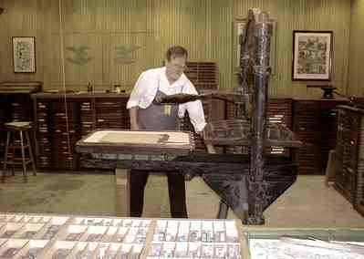 Pensacola:-Historic-Pensacola-Village:-Museum-Of-Commerce_05.jpg:  printer, newspaper printing, linotype, movable type, printing press, museum, historical reenactment, historic village