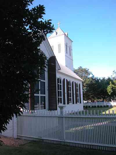 Pensacola:-Historic-Pensacola-Village:-Old-Christ-Church_05.jpg:  plaque, historic marker, brick structure, religious service, church house, victorian village