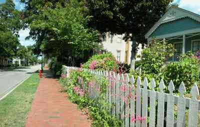 Pensacola:-Historic-Pensacola-Village:-Phieffer-House_01.jpg:  picket fence, brick sidewalk, shotgun cottage, dorr house, magnolia tree