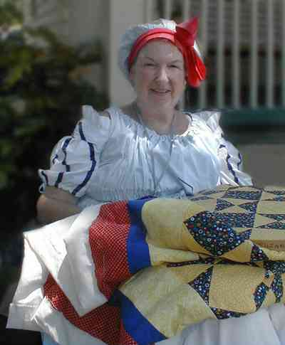 Pensacola:-Historic-Pensacola-Village:-The-Weavers-Cottage_06.jpg:  quilting, reenactor, colonial period, historic reenactment, quilt, weaving, historic village