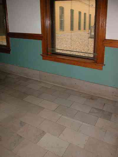 Pensacola:-Palafox-Historic-District:-Blount-Building_04.jpg:  marble floor, casement window, wainscotting