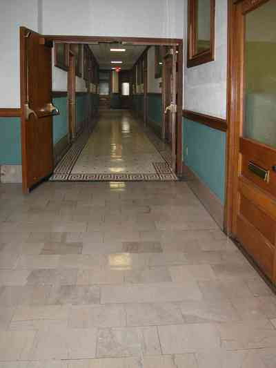 Pensacola:-Palafox-Historic-District:-Blount-Building_05.jpg:  marble floor, casement window, terrazzo tile floor, wainscotting