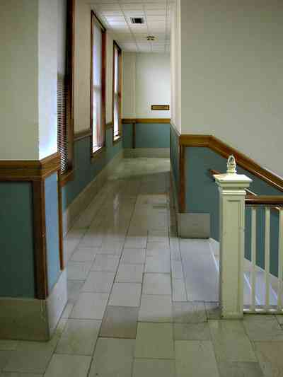 Pensacola:-Palafox-Historic-District:-Blount-Building_07.jpg:  marble floor, casement window, stairwell, staircase, wainscotting