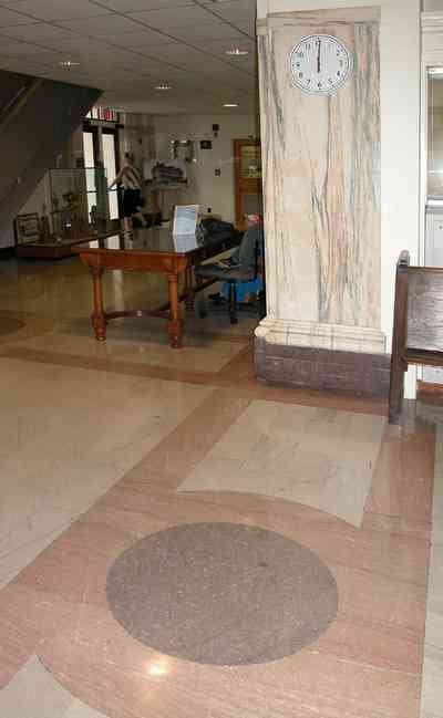 Pensacola:-Palafox-Historic-District:-Escambia-County-Courthouse_05.jpg:  marble floor, marble walls, oak table, foyer, entrance, courthouse, public building