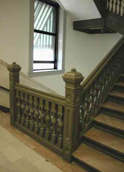 Pensacola:-Palafox-Historic-District:-Escambia-County-Courthouse_09b.jpg:  marble floor, marble walls, oak table, foyer, entrance, courthouse, marble staircase, iron balustrade, public building,