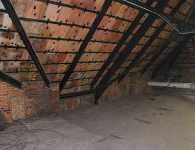 Pensacola:-Palafox-Historic-District:-Escambia-County-Courthouse_10.jpg:  attic, roof tiles, metal spring tension braces, brick walls