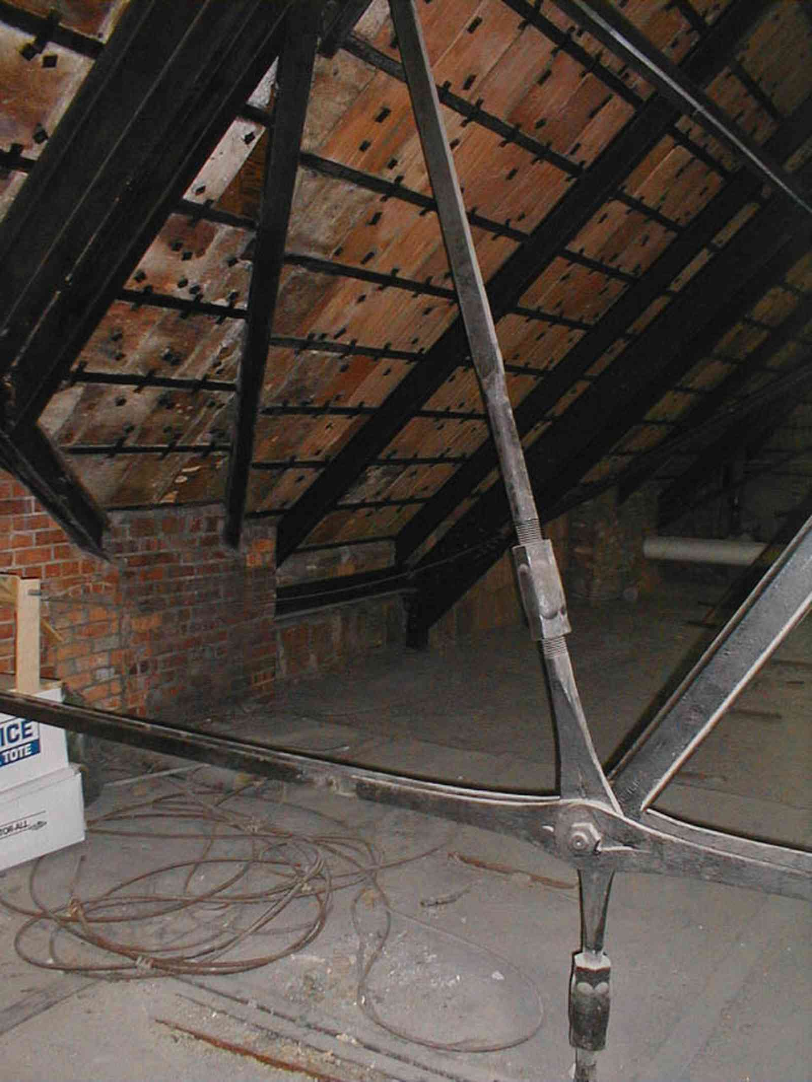 Pensacola:-Palafox-Historic-District:-Escambia-County-Courthouse_11.jpg:  attic, roof tiles, metal spring tension braces, brick walls
