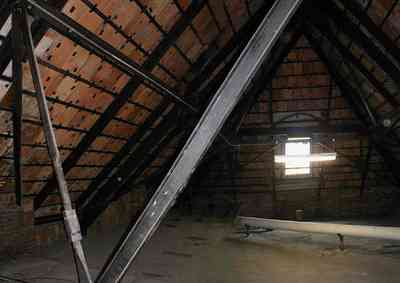 Pensacola:-Palafox-Historic-District:-Escambia-County-Courthouse_12.jpg:  attic, roof tiles, metal spring tension braces, brick walls