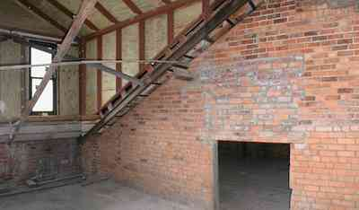 Pensacola:-Palafox-Historic-District:-Escambia-County-Courthouse_13.jpg:  attic, roof tiles, metal spring tension braces, brick walls