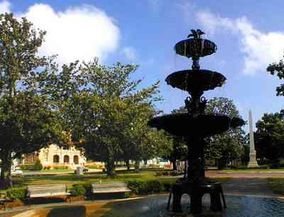 Pensacola:-Palafox-Historic-District:-Ferdinand-Plaza_02.jpg:  town square, plaza, obelisk, stone wall, oak trees, magnolia trees, historic district, courthouse, t. t. wentworth, jr. museum, fountain, empire building