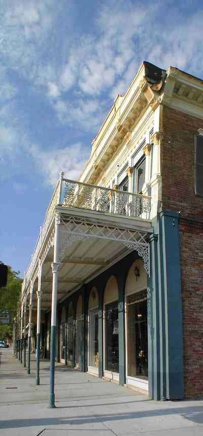 Pensacola:-Palafox-Historic-District:-Penko-Restaurant-Supply_02.jpg:  historic district, restaurant supply, victorian building, metal work, wrought iron, balcony