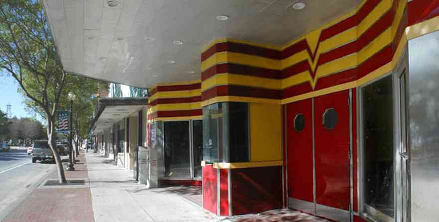 Pensacola:-Palafox-Historic-District:-Rex-Theatre_00a.jpg:  theater facade, art deco building, movie theater, stainless steel trim,