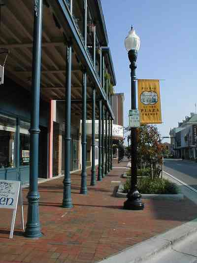 Pensacola:-Palafox-Historic-District:-Saenger-Theatre_01a.jpg:  streetscape, wrought-iron balcony, street lamp, brick sidewalk