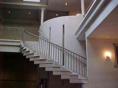 Pensacola:-Palafox-Historic-District:-Saenger-Theatre_03e.jpg:  movie lobby, movie theatre, curving staircase
