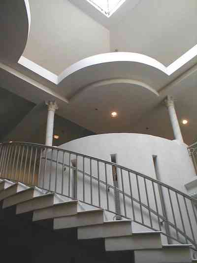 Pensacola:-Palafox-Historic-District:-Saenger-Theatre_04.jpg:  movie theatre, lobby, curving staircase, sky light