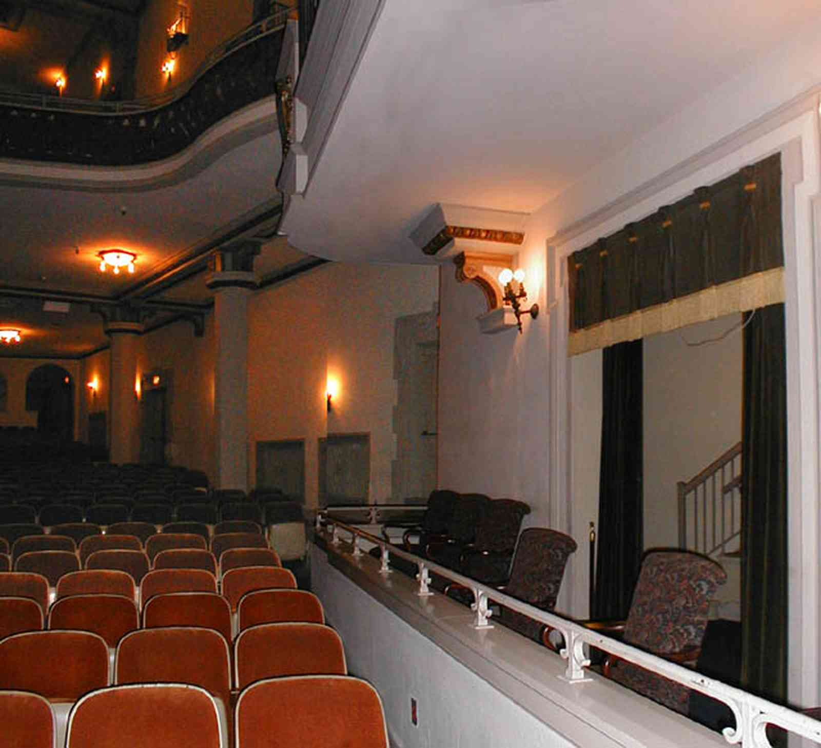 Pensacola:-Palafox-Historic-District:-Saenger-Theatre_05b.jpg:  theatre, balcony, box seating, velvet seats, stage, fringed curtains, stairs, opera house, philharmonic symphony orchestra, baroque architecture