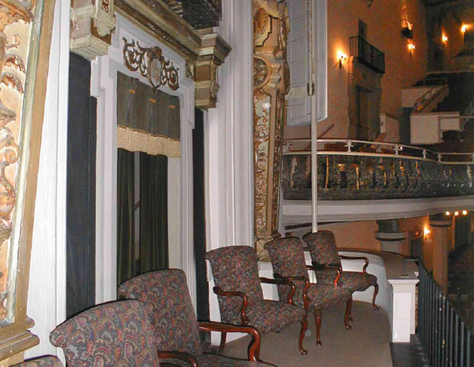 Pensacola:-Palafox-Historic-District:-Saenger-Theatre_10c.jpg:  movie theatre, second floor balcony, box seats, velvet curtains, spanish revival architecture, wrought iron balcony