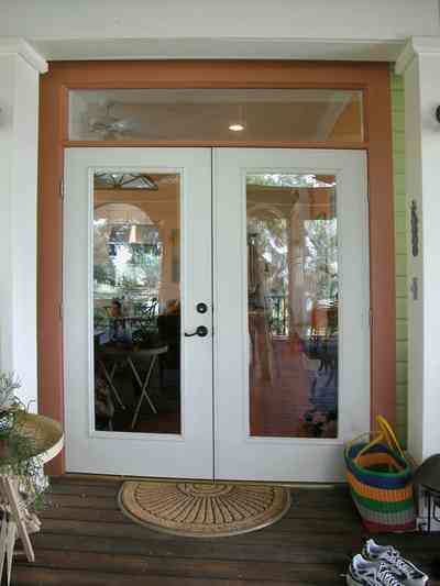 Pensacola:-Seville-Historic-District:-202-Cevallos-Street_23.jpg:  back porch, wooden deck, floor mat, glass doors, transom, victorian cottage