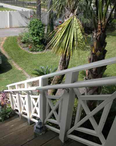Pensacola:-Seville-Historic-District:-202-Cevallos-Street_29.jpg:  staircase, side stairs, back porch, palm tree, wooden steps, picket fence, victorian cottage