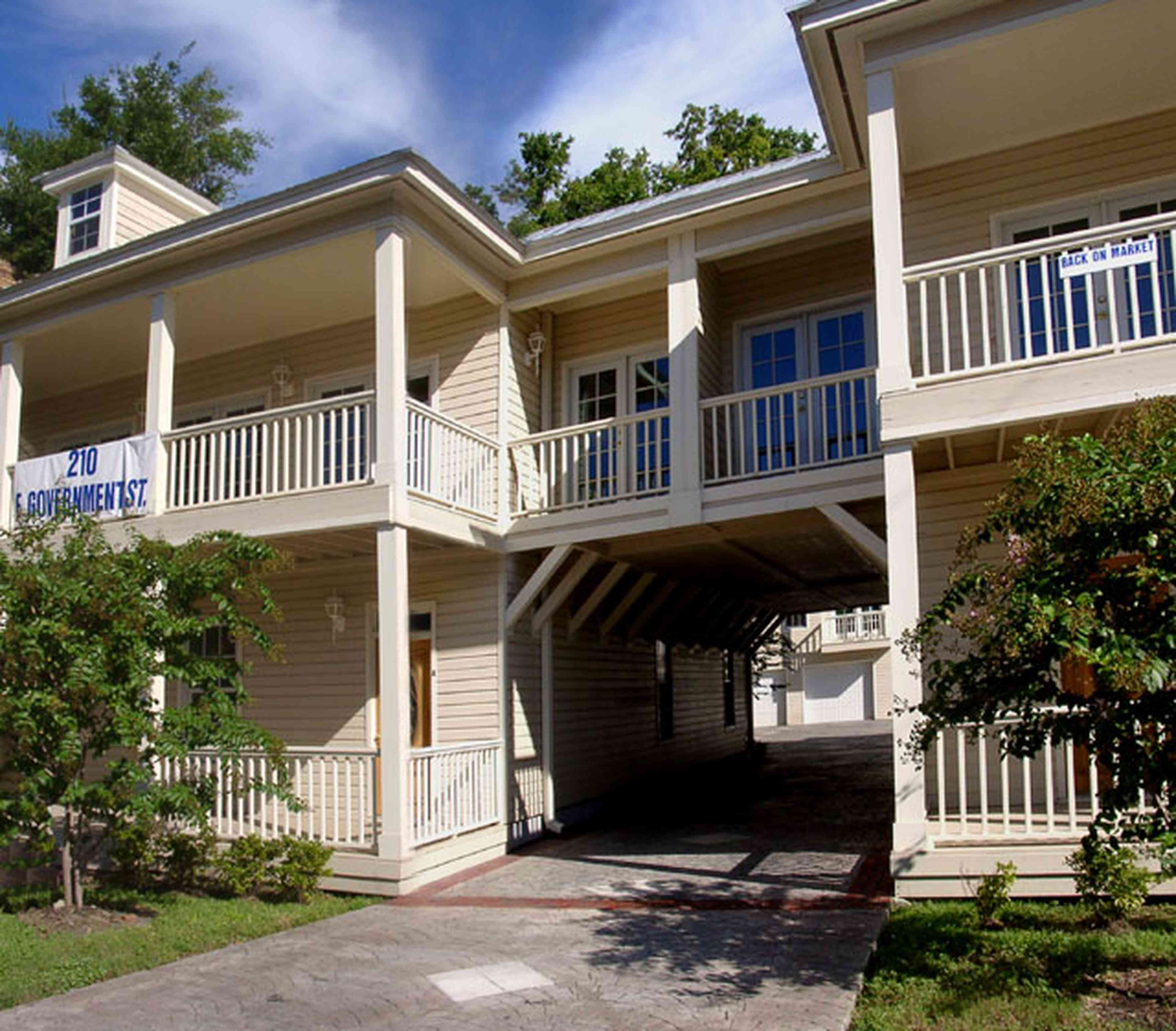 Pensacola:-Seville-Historic-District:-210-East-Government-Street_01.jpg:  multi-use building, crepe myrtle tree, condo, porches, french doors, carriage house, victorian building