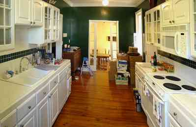 Pensacola:-Seville-Historic-District:-211-Cevallos-Street_04.jpg:  gallery kitchen, historic home, hardwood floors, dinign room, cevallos street