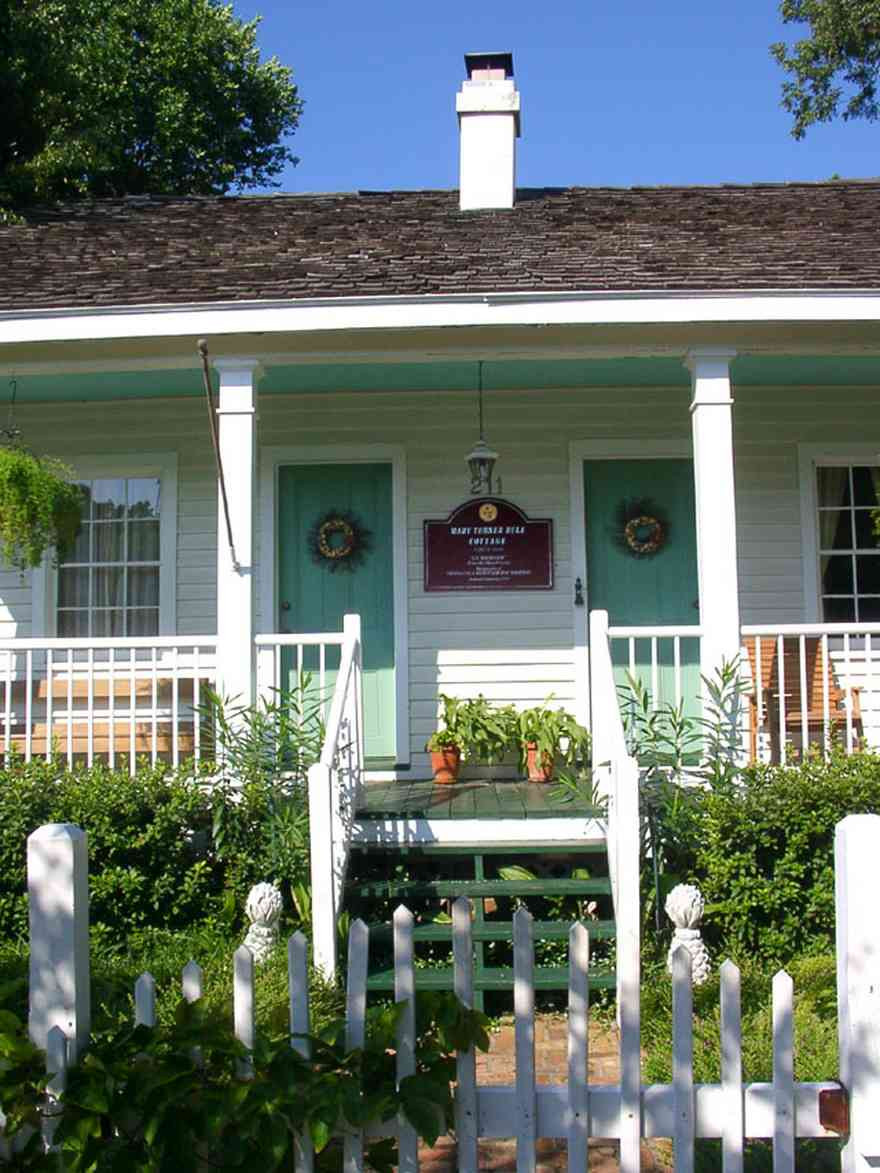 Pensacola:-Seville-Historic-District:-211-South-Florida-Blanca-Street_00.jpg:  creole cottage, picket fence, porch, wood shingle roof