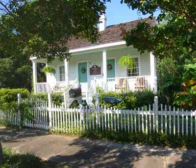 Pensacola:-Seville-Historic-District:-211-South-Florida-Blanca-Street_01.jpg:  picket fence, creole cottage, porch