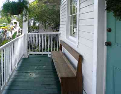 Pensacola:-Seville-Historic-District:-211-South-Florida-Blanca-Street_10.jpg:  deacons bench, porch, gulf coast cottage