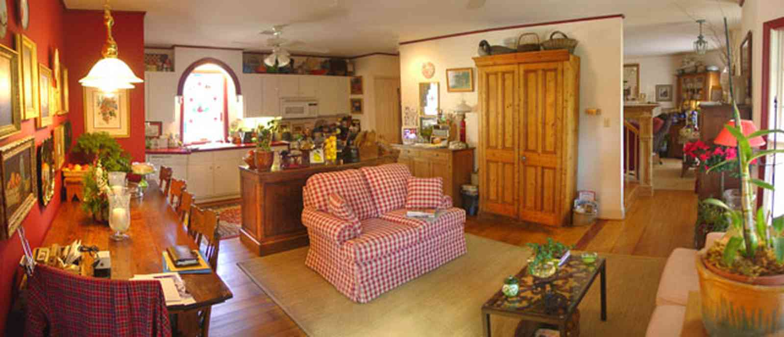 Pensacola:-Seville-Historic-District:-227-East-Intendencia-Street_07.jpg:  sofa, kitchen, folk victorian home, armoire, orchid plant,