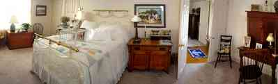 Pensacola:-Seville-Historic-District:-227-East-Intendencia-Street_17.jpg:  folk victorian house, bedroom, brass bed