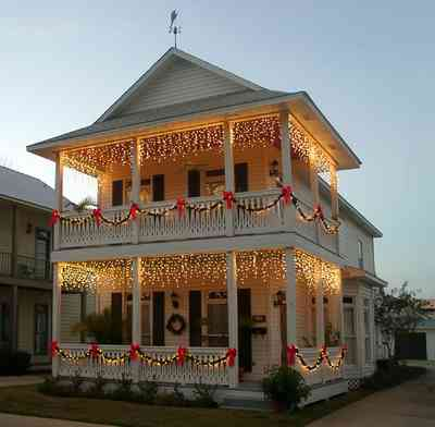 Pensacola:-Seville-Historic-District:-426-East-Intendencia-Street_02.jpg:  christmas decorations, bows, garland, wreath, victorian shotgun cottage, weather vane