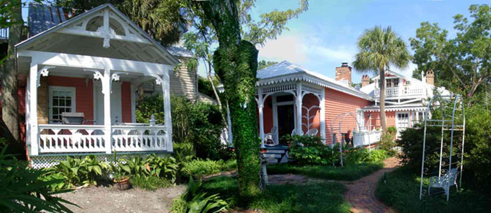 Pensacola:-Seville-Historic-District:-433-East-Zaragoza-Street_10.jpg:  victorian cottage, wicker furniture, victorian house, garden house, brick sidewalk, gingerbread trim, pyramidal roof, four-square georgian victorian house