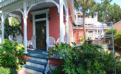 Pensacola:-Seville-Historic-District:-433-East-Zaragoza-Street_13.jpg:  victorian cottage, victorian house, victorian porch, widows walk, wicker furniture, laticework, palm tree, pecan tree