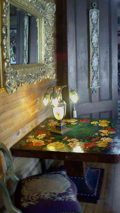 Pensacola:-Seville-Historic-District:-433-East-Zaragoza-Street_33.jpg:  roses, rococco mirror, tiffany lamp, tapestry chair, victorian house
